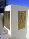 Custom-Manufactured-Brass-Grates-in-Wall-Application